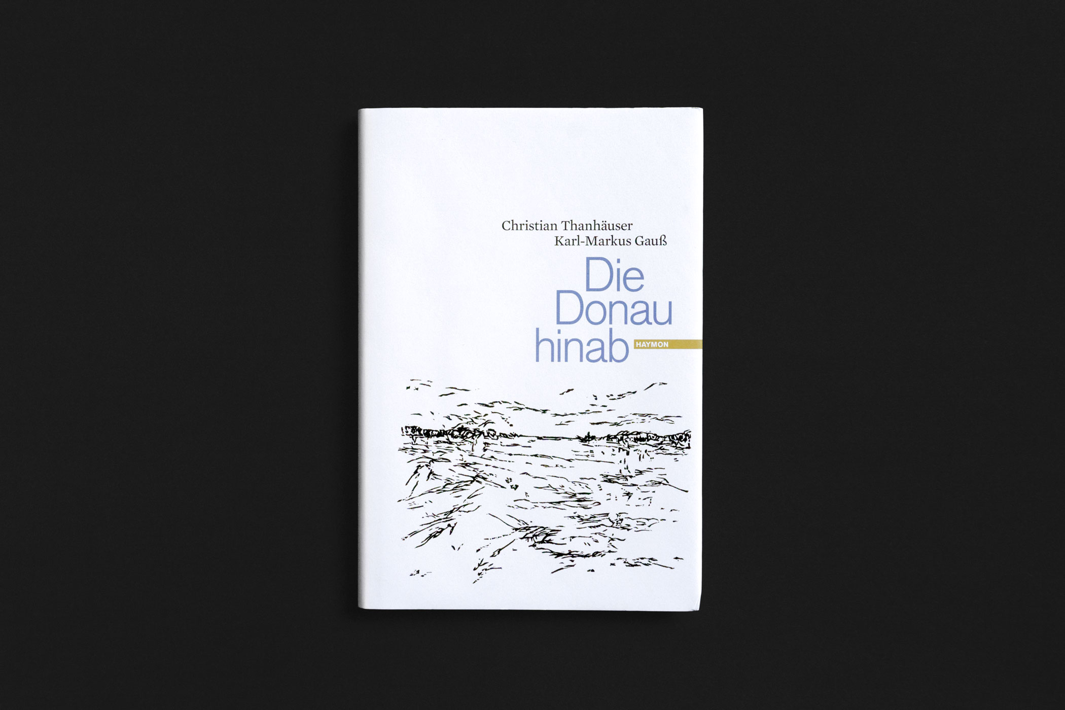 """Das Buch """"Die Donau hinab"""" von Christian Thanhäuser und Karl-Markus Gauß erschienen im Verlag Haymon mit einem Holzschnitt der Donau von Christian Thanhäuser am Umschlag"""